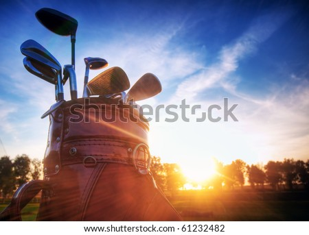Professional golf gear on the golf course at sunset. - stock photo