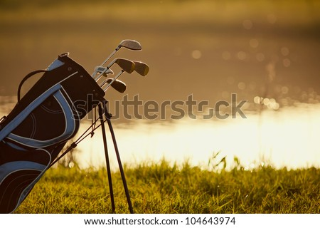 Professional golf gear on the golf course at sunset near the lake