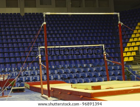 Professional gymnastic uneven bars in sport palace