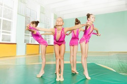 Professional gymnasts forming circle holding hands