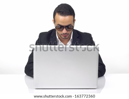 Professional hacker working on laptop