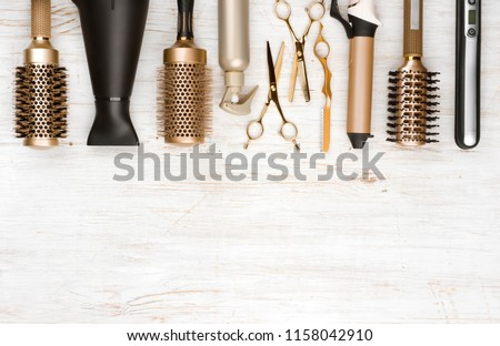 Professional hair dresser tools on wooden background with copy space #1158042910