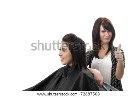 Professional hair stylist with client in chair giving thumbs up