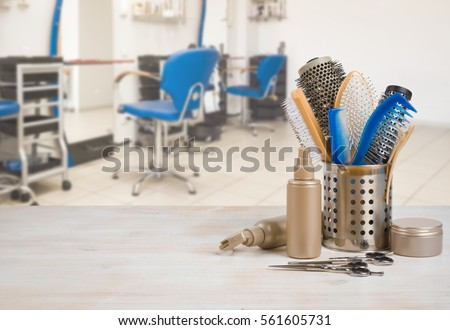 Professional hairdresser tools on table over defocused salon interior background. #561605731