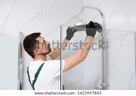 Professional handyman working in shower booth indoors Photo stock ©