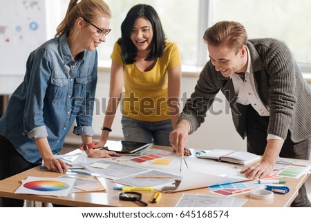 Professional hard working colleagues developing a new design