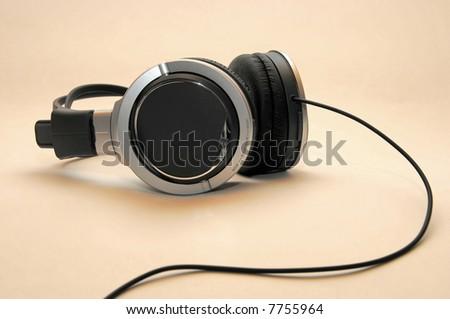 Professional Headphones on warm background - stock photo