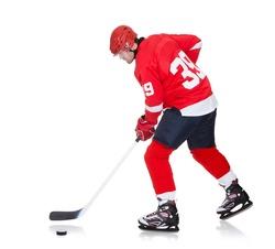 Professional hockey player skating on ice. Isolated on white