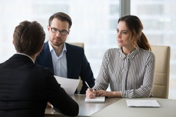 Professional hr recruiting company managers holding resume interviewing job applicant, employers recruiters listen seeker at interview make hiring decision at employment negotiation, staffing concept