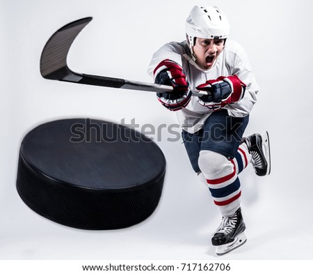 Professional ice hockey player is forward skating on ice, copy space, isolated, white background.