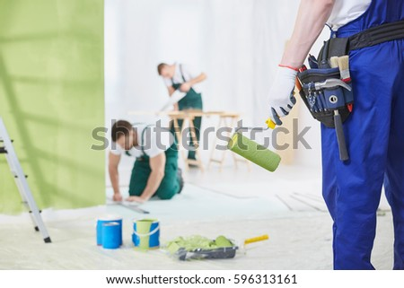 Professional interior renovation crew at work in house