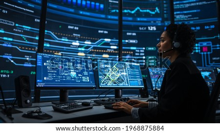 Professional IT Technical Support Specialists and Software Programmer Working on Computers in Monitoring Control Room with Digital Screens with Server Data, Blockchain Network and Surveillance Maps. Сток-фото ©