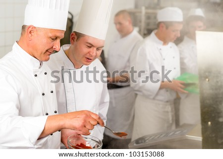 Professional kitchen chef cook add spice paprika prepare food meals