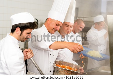 Professional kitchen happy chef prepare food meal international cuisine