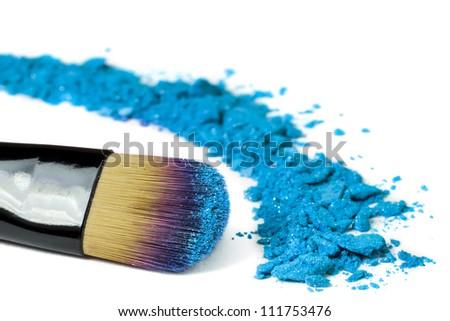 Professional make-up brush on blue crushed eyeshadow