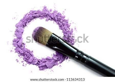 Professional make-up brush on purple crushed eyeshadow