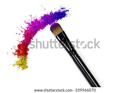 Professional make-up brush on rainbow crushed eyeshadow