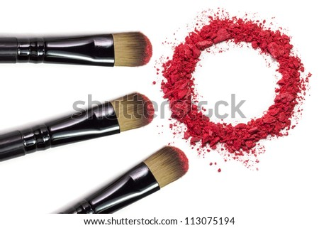 Professional make-up brush on red crushed eyeshadow