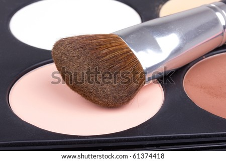 Professional make-up brush on white eyeshadows, closed-up