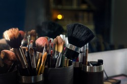 Professional makeup brushes set closeup near salon mirror