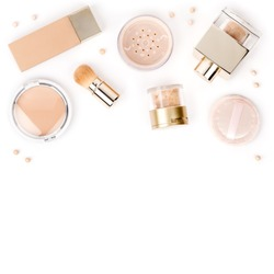 professional makeup cosmetics to even out skin tone: foundation, face powder and concealer isolated on white background with copy space for text. beauty, fashion, shopping concept. flat lay, top view