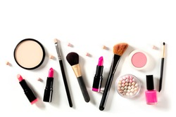 Professional makeup on a white background. Brushes, lipstick and other products, a flat lay with copy space
