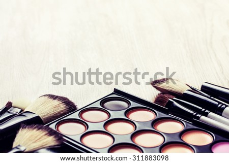Professional makeup palette, makeup brushes, makeup products  with copyspace (Toning, instagram filter)