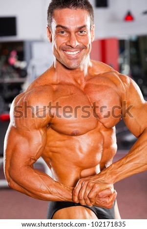 professional male bodybuilder posing in gym
