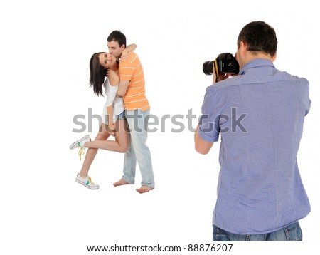 professional male photographer making family picture at studio. isolated