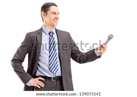 Professional male reporter holding a microphone, isolated on white background