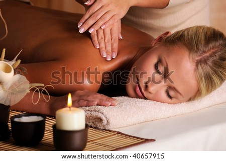 professional masseur doing  massaging  female neck  in the beauty salon