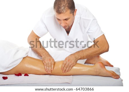 Professional masseur giving anti cellulite leg massage to a woman at spa resort