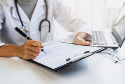 Professional medical doctor consulting and inquired about patient's history at hospital and report the health examination results, Health care concept