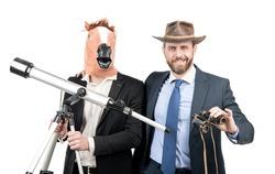 Professional men use telescope and binoculars for observation. Market observation