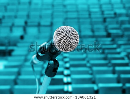 Professional microphone against concert hall