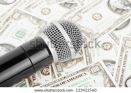 Professional microphone and money, against money