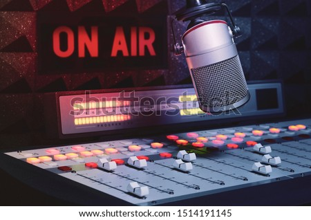 Professional microphone and sound mixer in radio station studio