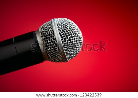 Professional microphone on red background