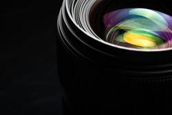 Professional modern DSLR camera llense ow key image - Modern DSLR camera lense with a very wide aperture