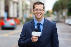 professional news reporter live broadcasting on urban street