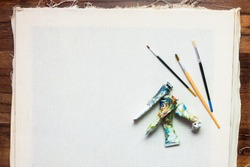 Professional painter workplace flat lay. Oil paints, brushes, canvas. Artist's equipment assortment background. Drawing lessons, art school, young painter, creativity, DIY concept