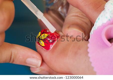 Professional pedicure beauty procedure. Beauty salon. - stock photo