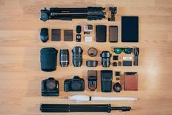 Professional photo camera kit is neatly folded on wood surface