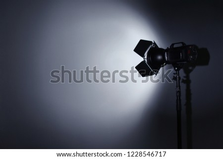 Professional photo studio lighting equipment on dark background. Space for text Foto stock ©