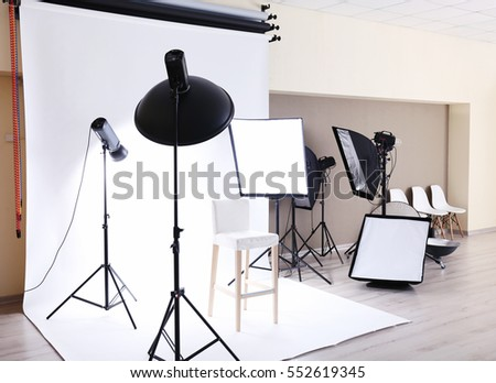 Professional photo studio with lighting equipment #552619345