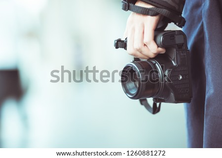 Professional photographer landscape with dslr camera in smart woman hands for ready to take pictures, Photographers takes snapshots for pleasure to remember events, vintage tone