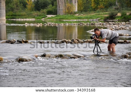 Professional photographer working under difficult circumstances