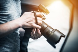 Professional Photography Job Concept. Photographer with Modern Digital Camera in Hand