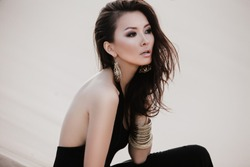 Professional photoshoot of beautiful young sexy asian woman in desert