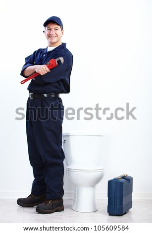 Professional plumber doing toilet reparation. Plumbing repair service. - stock photo